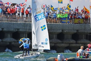 Anton Dahlberg of Sweden and Fredrik Bergstrom of Sweden greet their supporters as they celebrate winning silver after the men's 470 sailing race.