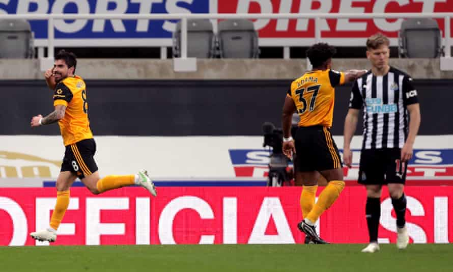 Rúben Neves celebrates scoring Wolves' equaliser while Matt Ritchie is disconsolate