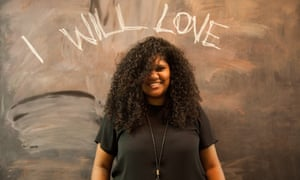 "LaVonne Bobongie for IndigenousX in front of a blackboard with ""I will love"" written in chalk"