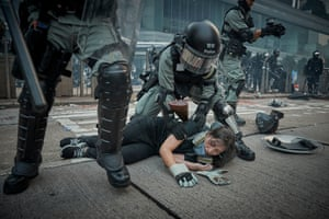 Police arrest a demonstrator during a march on Hong Kong Island on 29th September 2019