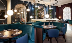 A huge ballroom-like space with happening beats, banquettes and blocks of curving booths: the dining room of The Soak, in London's Victoria.