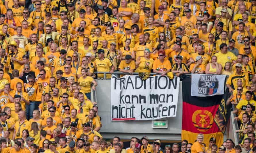 """Dynamo Dresden fans unfurled banners reading """"you cannot buy tradition"""" and """"No to RB"""" during their team's Cup match against Red Bull Leipzig in August."""