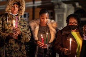 London, UK A small group hold a candlelit vigil to mark what would have been the birthday of George Floyd, in Windrush Square in Brixton