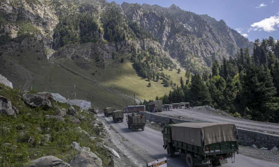 An Indian army convoy moves on the Srinagar- Ladakh highway in September. Both India and China are withdrawing troops from their disputed border area.