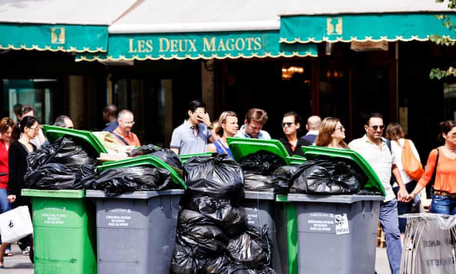 Rubbish piled up outside Les Deux Magots, one of Paris's famous left-bank cafes.