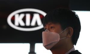 A man wears a face mask at the Kia standat the India Auto Expo 2020 in Greater Noida last week.