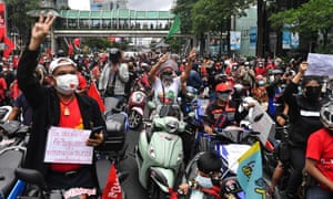 Protesters make a three-finger salute as they gather for a demonstration in Bangkok calling for the resignation of Thailand's prime minister over the government's handling of the coronavirus crisis.