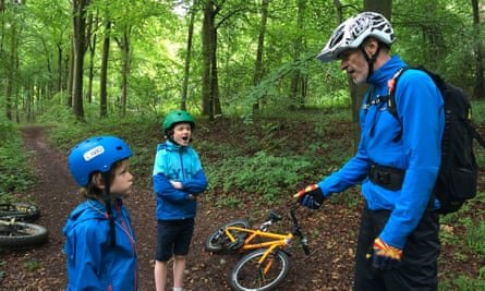 Mountain biking in the Houghton Forest, West Sussex. The writer's children hang on every word of guide, Jim Barrow.