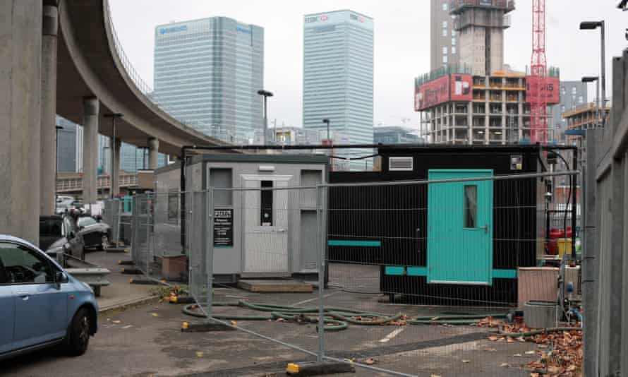 Deliveroo's dark kitchens under a railway line in Blackwall, east London, in the shadow of Canary Wharf's gleaming office towers.