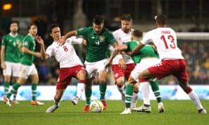 Republic of Ireland's Shane Long (centre) battles for the ball with Denmark's Thomas Delaney (left).