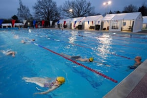 Swimmers using Hampton lido this morning as outside pools in England opened for the first time after lockdown.