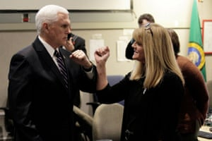 This is Pence making sure not to shake hands when greeting a woman at the Washington State Emergency Operations Center during a tour with state governor Jay Inslee near Tacoma, Washington state, yesterday.