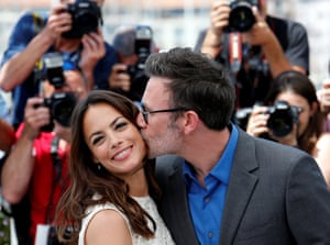 French director Michel Hazanavicius and French-Argentinian actress Berenice Bejo kiss during a photocall for the film 'The Redoubtable