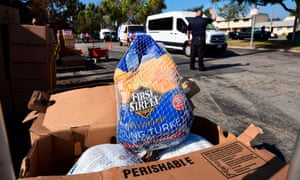 People arrive in their vehicles for a distribution of frozen turkeys and food boxes ahead of Thanksgiving to families affected by the Covid-19 pandemic in Los Angeles, California. The annual Operation Gobble Gobble event is organized by Supervisor Hilda Solis and 43 nonprofit organisations.