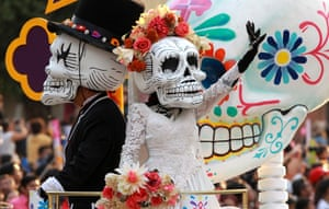 People dressed as skeletons and Mexican popular character Catrina participate in a parade to mark the Day of the Dead in Mexico City