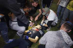 Paramedics treat a wounded demonstrator