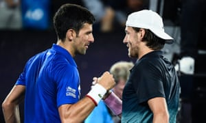 Novak Djokovic shakes hands with Lucas Pouille after their one-sided semi-final.
