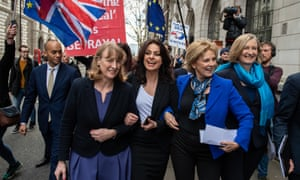 Former Labour party MP Joan Ryan (left) links arms with former Conservative MPs Heidi Allen (second left), Anna Soubry (second right) and Sarah Wollaston (right) as they arrived at a press conference on their resignations today.