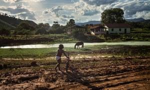 child plays near mud