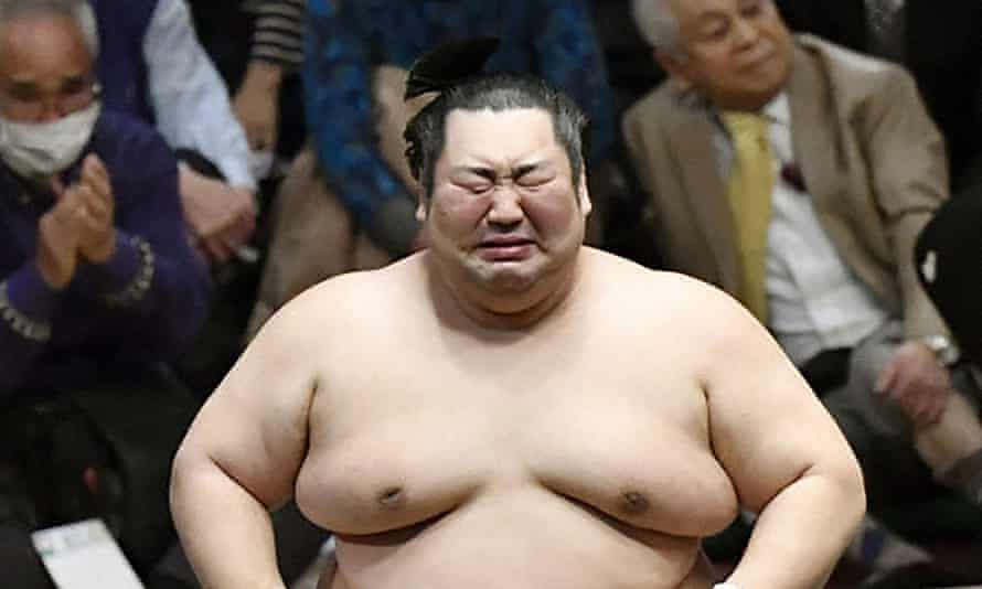Underdog Tokushoryu reacts after beating champion wrestler Takakeisho at the new year tournament in Tokyo on Sunday.