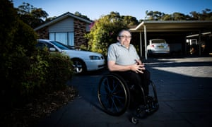 David Belcher, a Lake Macquarie councillor sits in the drive way of his Brightwaters home on the Central Coast.