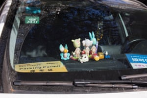 Small figures on the dashboard of a car