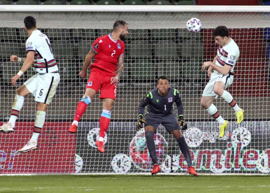 Diogo Jota (right) leaps to score against Luxembourg.