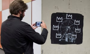 The other new Banksy mural uses crown motifs, which are common in some of Basquiat's art.
