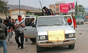 Armed civilians patrol the town of Chilapa, Mexico.