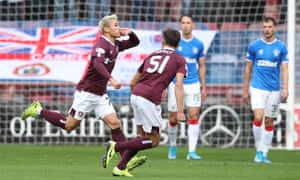 Ryotaro Meshino wheels away after an expertly-taken lob gave Hearts the lead.