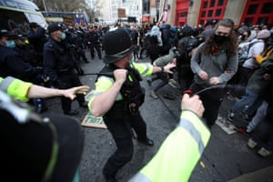 A police officer uses pepper spray.