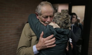 Erri De Luca is hugged by a supporter after a court in Turin cleared him of inciting criminal damage to property.