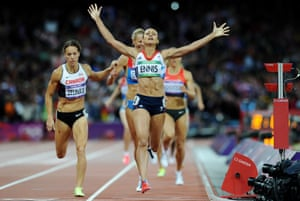 At the London 2012 Olympic Games, Jessica Ennis wins gold for Britain in the women's heptathlon and celebrates after crossing the line in the final event, the 800 metres. 4 August.