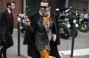 A real street-style star at Paris men's fashion week: never knowingly underscarved.