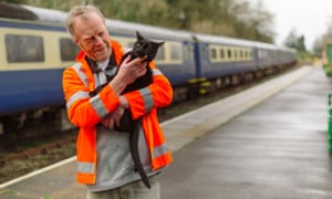 Paul Martin, duty manager, at Okehampton station with Percy, the station cat