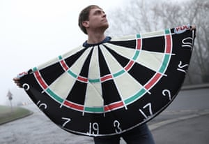 Bullseye! A fan dressed as a dartboard poses outside Alexandra Palace