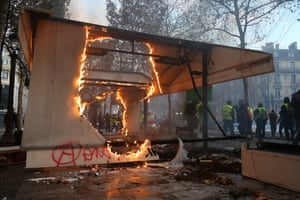 Anarchists leave their mark on a burnt out pavillion.