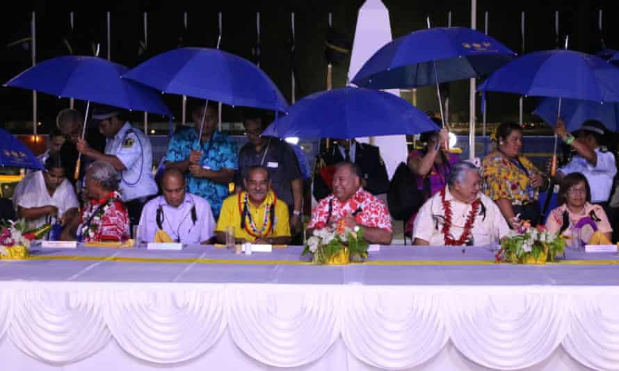 Leaders, including Nauru President Baron Waqa (centre in red shirt) at the opening ceremony of the Pacific Islands Forum in Yaren on Monday.