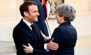 Emmanuel Macron, the French president, welcomes Theresa May to the Elysee Palace.