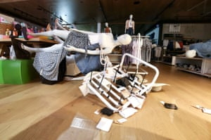 A mannequin in Cotton On clothing store lies on a table after an earthquake