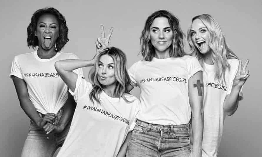 Members of the Spice Girls wearing #IWannaBeASpiceGirl T-shirts