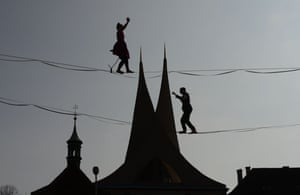 Tightrope artists cross in front of the Emmaus monastery in Prague.