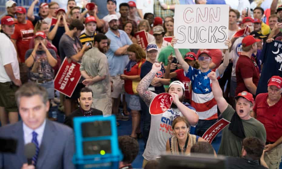 President Trump Attends Campaign Rally For SC Gov. McMasterWEST COLUMBIA, SC - JUNE 25: People shout behind CNN reporter Jim Acosta before a campaign rally for South Carolina Governor Henry McMaster featuring President Donald Trump at Airport High School June 25, 2018 in West Columbia, South Carolina. (Photo by Sean Rayford/Getty Images)