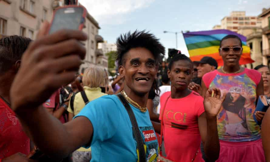 People take part in the gay pride parade in Havana