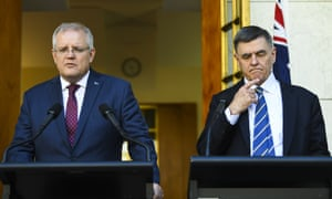 Australian Prime Minister Scott Morrison (left) and Australia's Chief Medical Officer Professor Brendan Murphy speak to the media during a press conference at Parliament House in Canberra, Wednesday, March 11, 2020.