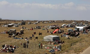 Internally displaced people from Deraa province are gathered near the Israeli-occupied Golan Heights in Quneitra, Syria.