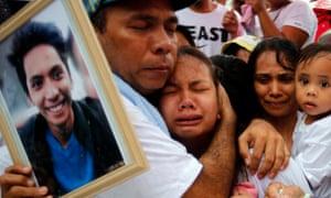 Relatives mourn Ephraim Escudero, the victim of an extrajudicial killing, in San Pedro city, Philippines.