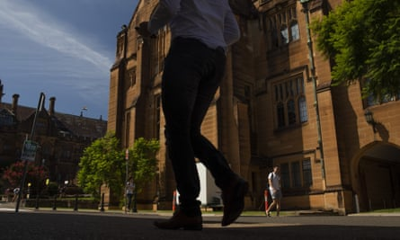Students walk past a building at the University of Sydney