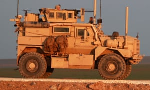 A US Marine Corps tactical vehicle is seen driving along a road near the town of Tal Baydar in Syria.