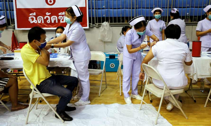 People receive the Sinovac coronavirus vaccine as the Thai resort island of Phuket rushes to vaccinate its population ahead of a 1 July ending of strict quarantine for overseas visitors.